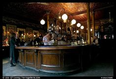 Picture/Photo: Central horseshoe bar in the 19th century victorian pub Princess Louise. London, England, United Kingdom