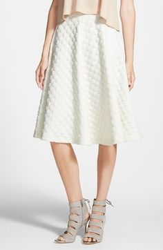JOA Polka Dot Midi Skirt at Nordstrom.com. A pleated midi skirt is embossed with polka dots and cut in an A-line silhouette.