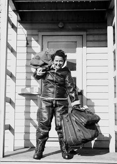 1943 - A Women Airforce Service Pilots (WASP) and her gear. - (vintage lady, old photo, World War II era, history)