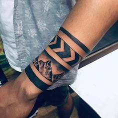 31 Best Black Band Tattoo Designs for Men You Can Try - Saggno Black Band Tattoo, Tribal Band Tattoo, Wrist Band Tattoo, Forearm Band Tattoos, Wrist Tattoos For Guys, Celtic Band Tattoo, Calve Tattoo, Arm Band Tattoo For Women, Bracelet Tattoo For Man