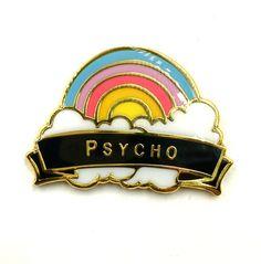 Pin inspired by a vintage travel pin. Let the world know what a psycho rainbow you are Measures 1.25 wide epoxy coating on top and locking back