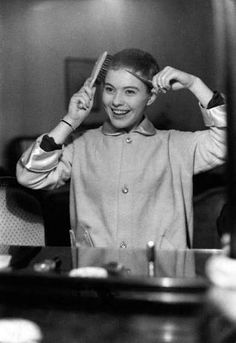 """girlinlondon: """" Jean Seberg cutting her hair with a comb and scissors for her role in the 1957 film Saint Joan directed by Otto Preminger. Jean Seberg, Pixie Cut Styles, Short Hair Styles, Vintage Hollywood, In Hollywood, Romain Gary, St Joan, Black Panther Party, Cut Her Hair"""