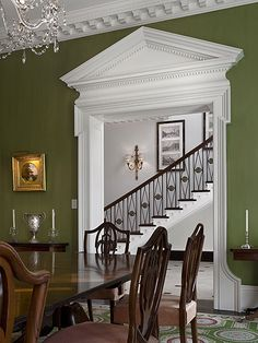 Beautiful....the door detail and crown molding are awesome and pops against the dark green walls.