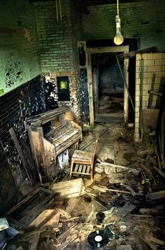 An abandoned schoolhouse music room, and what is left of the piano..