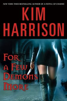 Kim Harrison's For A Few Demons More, original hard cover published March 20, 2007. This is the first time a weapon was used on a U.S. cover, but not the last.
