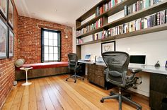 Exposed brick walls and industrial windows in the home office [Design: Todd Davis Architecture]