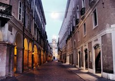 Modena-Italia Via Farini sullo sfondo Accademia Militare  I like how the light shows through the arches on the left.