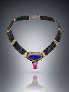 Image result for boulder opal set with gold