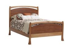 This contemporary Panel Bed is Amish made from in over eight different wood types including environmentally friendly Lyptus Wood.