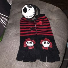 Bundle of Nightmare Before Christmas One pair of long fingerless gloves and one Jack Skellington earmuffs. Gloves never worn and earmuffs gently used. Disney Accessories Gloves & Mittens