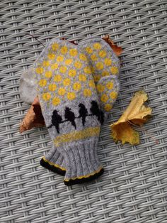 A very special pair of handknitted mittens - these are designed featuring the birds of our town, the crows from Moss! 26 cm / inch long and 10 cm / 4 inch wide. Colours are as picture - grey, black and yellow with a ribbed cuff Crochet Mittens, Mittens Pattern, Fingerless Mittens, Knitted Gloves, Knit Crochet, Fair Isle Knitting, Knitting Socks, Hand Knitting, Wrist Warmers