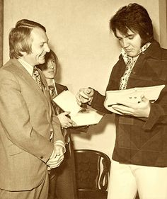 Elvis receives an award from a British fan club.
