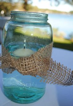 blue mason jars with burlap ties :)