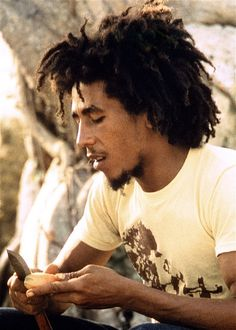 Bob Marley cooks, Westmoreland, Jamaica, 1974.   Bob Marley in his late-20s cooking Ital food, a vegetarian diet followed by    most Rastafarians, designed to promote a healthy mind, body and spirit.    Marley was raised as a Catholic, but converted by Rastafari in the 1960s,    and began to wear his trademark dreadlocks thereafter.     Messenger - The Bob Marley Exhibition is part of Jamaica 50, a celebration    of the 50 years of Jamaican independence was on at the O2 in London in 2012.