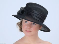 Margaret is a classy formal hat with an elegant flower arrangement and subtle feathers on a side. This headpiece is hand formed and sewed, making it an exclusive design. This artisan stylish hat would be a perfect ladies headwear for a day at the races. Would look great also in pastel colour.