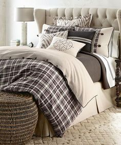 Rawlins Plaid Duvet Cover Plaid Duvet Cover by French Laundry: French Laundry Home, introduced by designer Debbie Jones in 2007, is a collection of bedding, tabletop linens, tabletop accessories, and furniture that is evocative of vintage French textiles and furnishings. Every item in the collection is crafted in the United States by local artisans and craftsmen