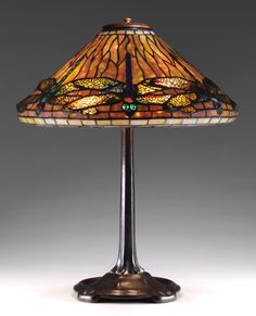 Tiffany Dragonfly leaded lamp f  eaturing dichroic background glass and a string of large dragonflies