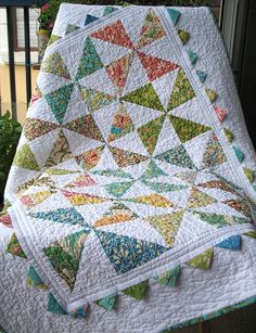 scrappy Pinwheel baby quilt all washed and finished! by soja, via Flickr