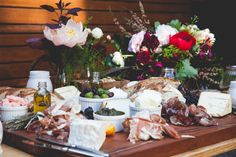 The picture above is one of my happy places, cheese, fresh cured meats, fruits and a glass of wine. Well that's how you win my heart and the grazing table concept is also an incredible way to cater to your wedding guests.