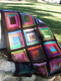 beautiful log cabin knitted afghan.  I finished a crocheted one and would love a reason to knit one.