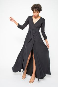Sensuously simple, this maxi wrap dress is crafted from a mid-weight, sueded silk. The fabric's refined matte ...