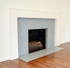 Magnificent blue Ocean Mini Glass Tile Fireplace Surround in white living room with laminated wood floor inspiring design ideas, Inspiring Tile Fireplace Surround Design Ideas: Ideas