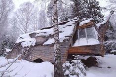 Perched above a creek near Lake Övre Gla in Sweden, this tiny log home is only 200 square feet.