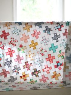 Today I'm sharing this lovely quilt top made by my Mom. I would like to say I helped…but all I did was hand her a pattern and eat all the chocolate in her house while she made this beautiful quilt.