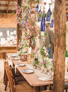Gorgeous! Love the bottles hanging from the ceiling and all the flowers!