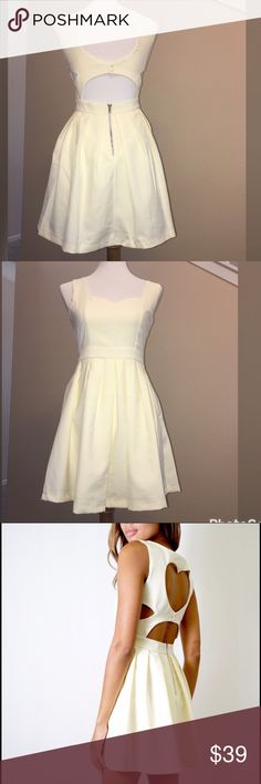 """🔥Ivory classic heart dress 👗 Tea & Cups Ivory classic heart dress with heart cutout back and pleated skirt. 100% polyester. Model on third picture is a small: total length 30""""/ across waist front: 12""""/ across chest front: 16"""". I have 1 small and 1 medium. New with tag. Price is final Tea n Cup Dresses Mini"""