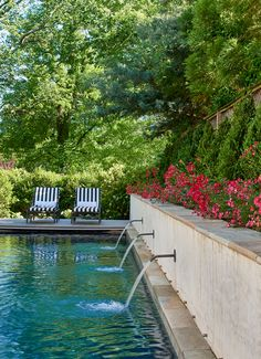 Jennifer Horn Landscape Architect | DC Spanish Colonial | A long, narrow swimming pool fits into the otherwise slim side yard. Bronze spouts, fabricated by a west coast artist, allow the pool to function as a decorative water feature.  #landscapearchitect #architecture #pool #pooldesign #gardendesign #gardenwall #gardendesign