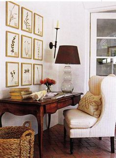 dens/libraries/offices - botanical photo gallery antique desk striped upholstered wingback wing back chair gray smoked glass gourd lamp brown silk lamp shade wicker basket candle black iron candle sconces terracotta tiles office French doors