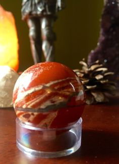 A personal favorite from my Etsy shop https://www.etsy.com/listing/270941553/awesome-red-jasper-sphere-crystal-ball