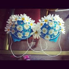 Daisy rave bra! I love how there are daisy around the top of the bra and in the middle. The turquoise blue matches the white daisies perfectly. This would be great for EDC. #raves #raveoutfits #bra Check out my board for more rave looks.