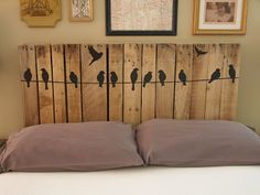 DIY Pallet Headboard ... she used Twelve Birds On A Wire Wall Sticker Decal 38 Inches ... sold on Amazon for $9.99 ... but you could also paint this graphic onto the boards yourself