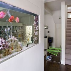Love the idea of having a fish tank in a wall...how would you clean it though?!