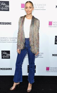 Nicole Richie in a fringe jacket and flare jeans