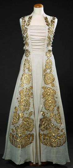 1930s white Evening dress with gold brocade floral accents.