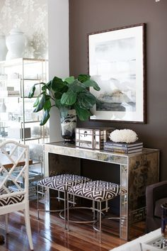 chocolate wall + mirrored console + brown geo fabrics