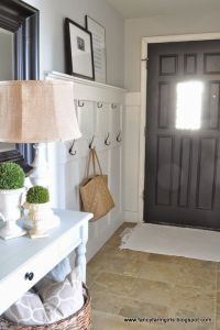 Benjamin Moore Gray Owl is one of the best light gray paint colours. Shown in entryway with dark painted front door