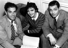"""Frank Capra going over the script with Claudette Colbert & Clark Gable on  """"It Happened One Night""""."""