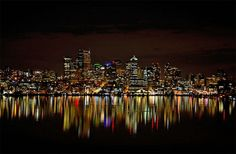 I found this panoramic picture really fun with all the different colors of the lights and how it displays a skyline at night and includes the reflections.