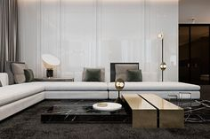 Every lamp in this apartment is a work of art in its own right – here, disk and sphere lights from Areti beautifully complement the sculptural low-set coffee table. In the daytime, the glossy white panel behind the sofa reflects enough natural sunlight to make even the darkest-themed interior look bright and cheerful.