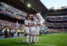 Real Madrid's players celebrate thier first goal during the Spanish league football match Real Madrid CF vs SD Eibar at the Santiago Bernabeu stadium in Madrid on April 9, 2016.