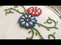 Video tutorial on Fancy Spider Web Flower Embroidery using Cast On Stitch, Chain Stitch, Lazy Daisy Stitch & Bead/Pearl Work. Embroidery Kits, Embroidery Designs, Flower Embroidery, Brazilian Embroidery Stitches, Casting On Stitches, Lazy Daisy Stitch, Sewing Stitches, Chain Stitch, Needlework