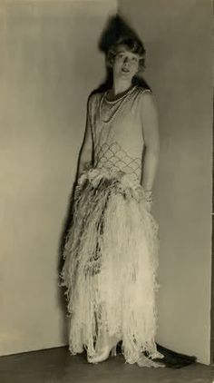 Actress Ina Claire in a feathered gown, by Louise Boulanger 1928