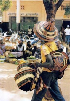 Africa | Hat seller at the big market.  Ouagadougou, Burkina Faso || Scanned postcard.