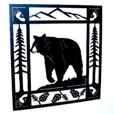 """One of our finer country home decorations, this Bear Scene Metal Wall Art is a laser cut rendition featuring a large black bear traveling through the woods. This exquisite metal wall art is available in hammered black or rust patina powder coat. The beautiful wrought iron wall art piece by Smoky Mountain is made in the USA and the perfect choice for rustic decorating. The hand crafted bear metal wall hanging is 30"""" H X 30""""W."""