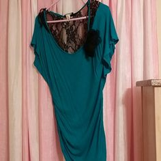 Dressy top Juniors turquoise top with black flower and some black lace,top of,back Deb Tops