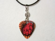 "METALLICA ""St Anger"" Necklace/Car Charm - Sexy Guitar Pick with Silver Charm. $9.50, via Etsy."